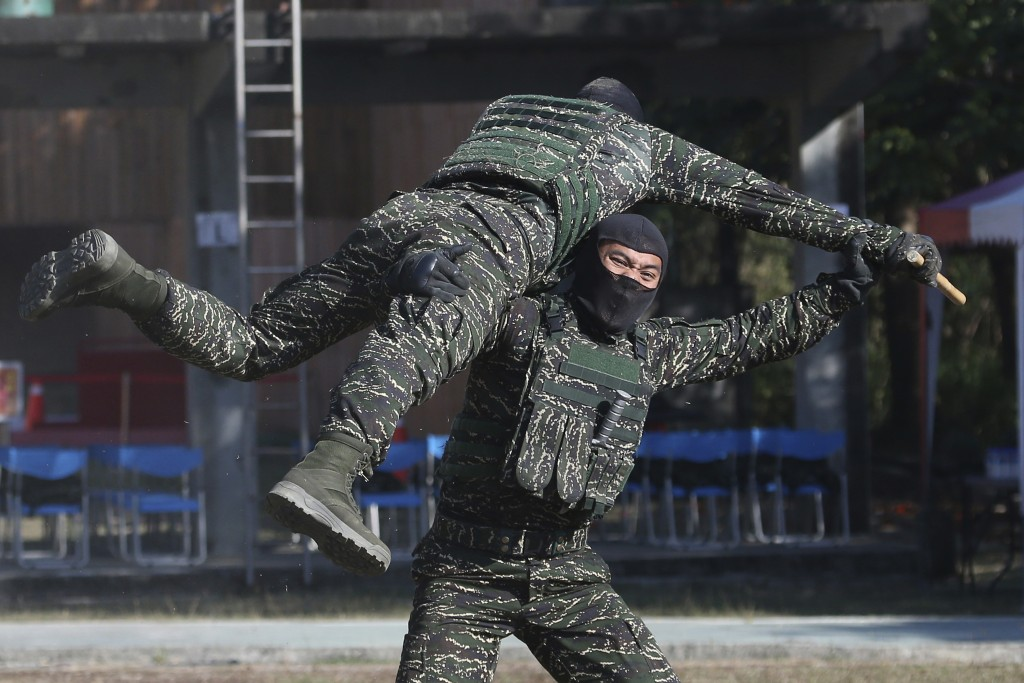 Members of Amphibious Search Team perform during a military exercise in Kaohsiung, southern Taiwan, Thursday, Jan. 16, 2020. Taiwan military is holdin...