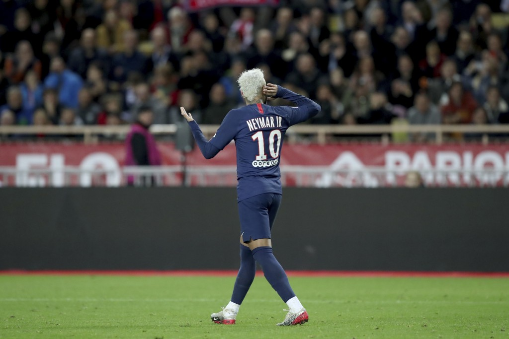 PSG's Neymar celebrates after scoring his side's second goal during the French League One soccer match between Monaco and Paris Saint-Germain at the L...