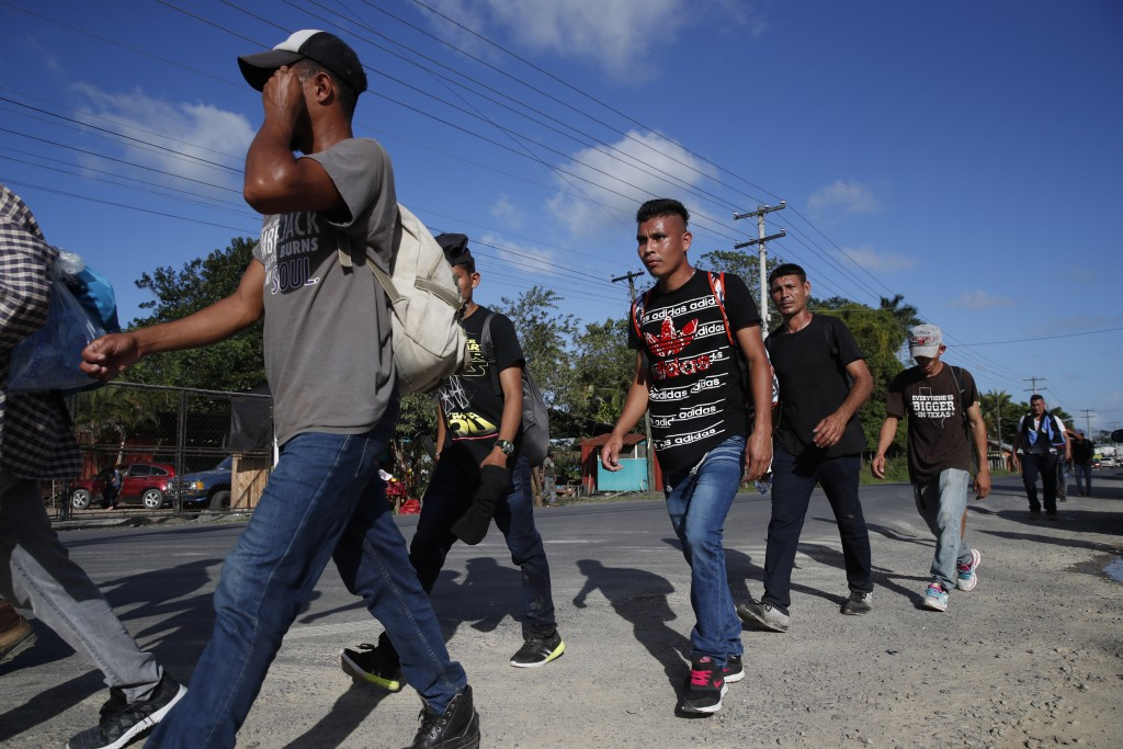 A group of migrants walk on their way to the United States, near El Cinchado, Guatemala, Wednesday, Jan. 15, 2020, on the border with Honduras. Hundre...