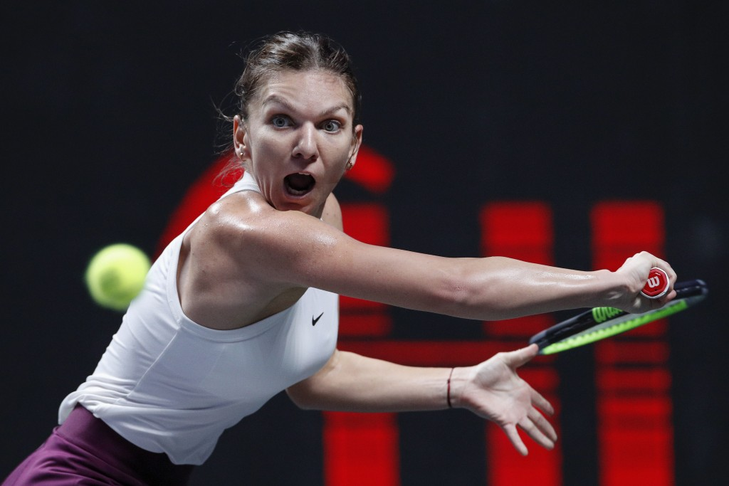 FILE - In this Oct. 28, 2019, file photo, Simona Halep, of Romani, eyes on the ball as she plays against Bianca Andreescu, of Canada, during their WTA...