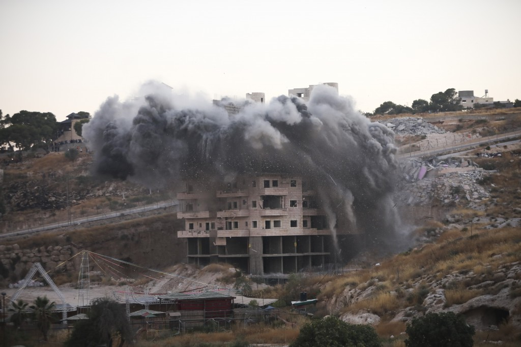 File - In this Monday, July 22, 2019 file photo, Israeli forces blow up a building in a Palestinian village of Sur Baher, east Jerusalem. Israeli advo...