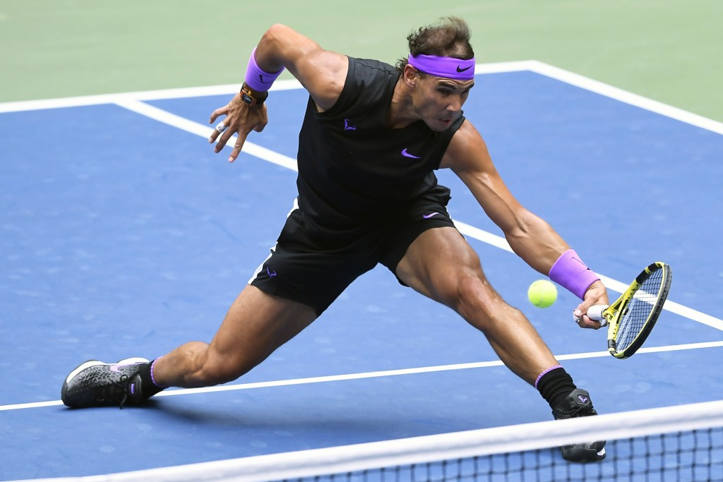 FILE - In this Sept. 8, 2019, file photo, Rafael Nadal, of Spain, returns a shot to Daniil Medvedev, of Russia, during the men's singles final of the ...