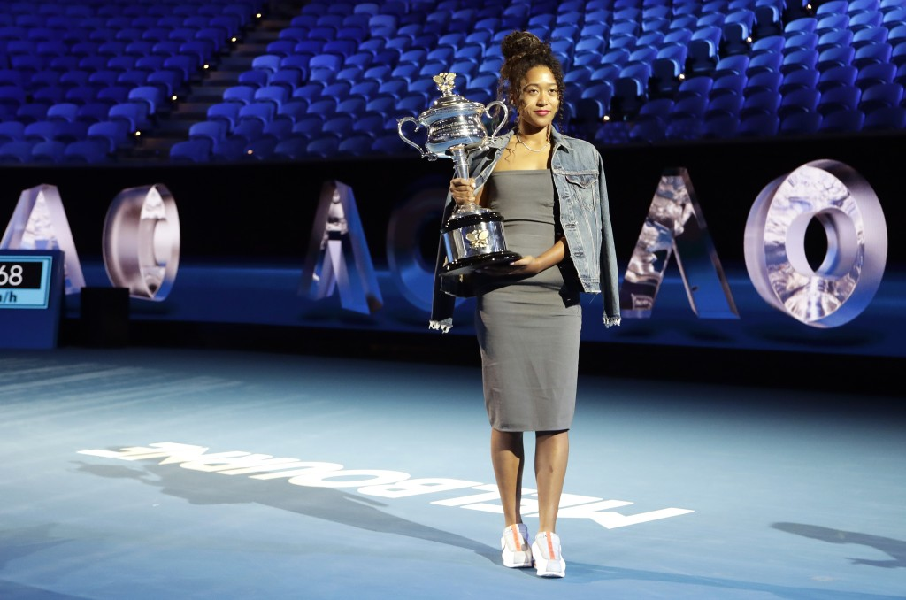 Defending woman's singles champion Japan's Naomi Osaka holds the Daphne Ackhurst Cup following the official draw ceremony on Margaret Court Arena ahea...