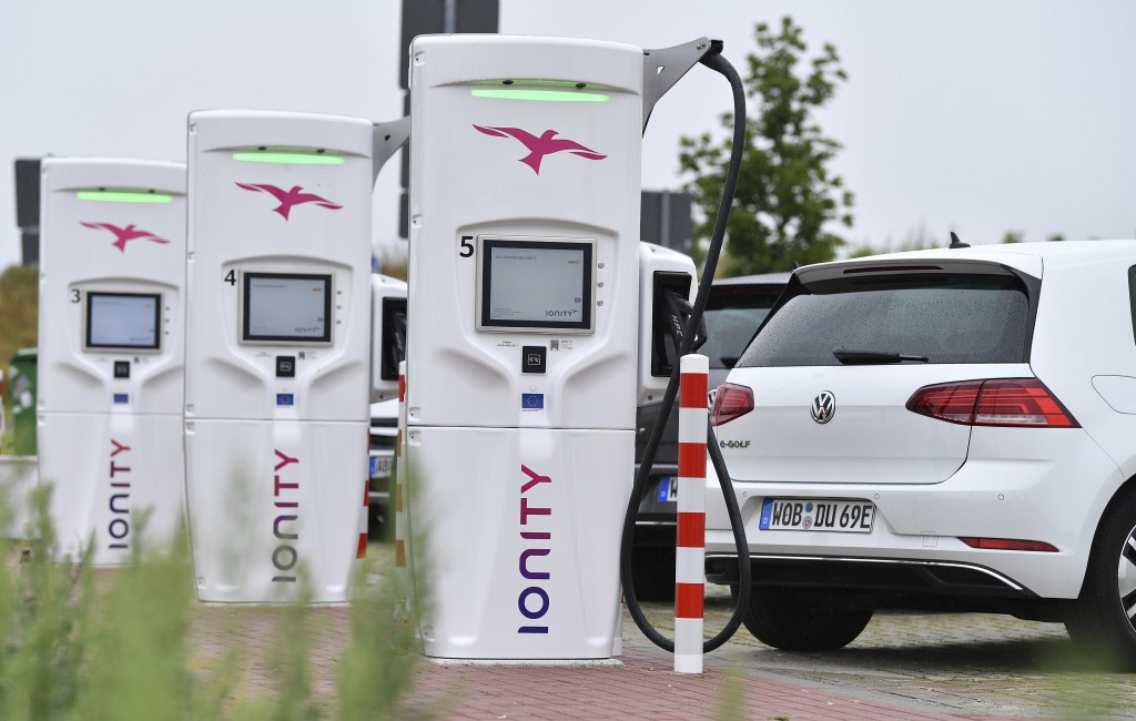 File---Picture taken July 19, 2019 shows the commissioning of an Ionity E super fast charging park,  with VW e-Golf  standing at the charging stations...
