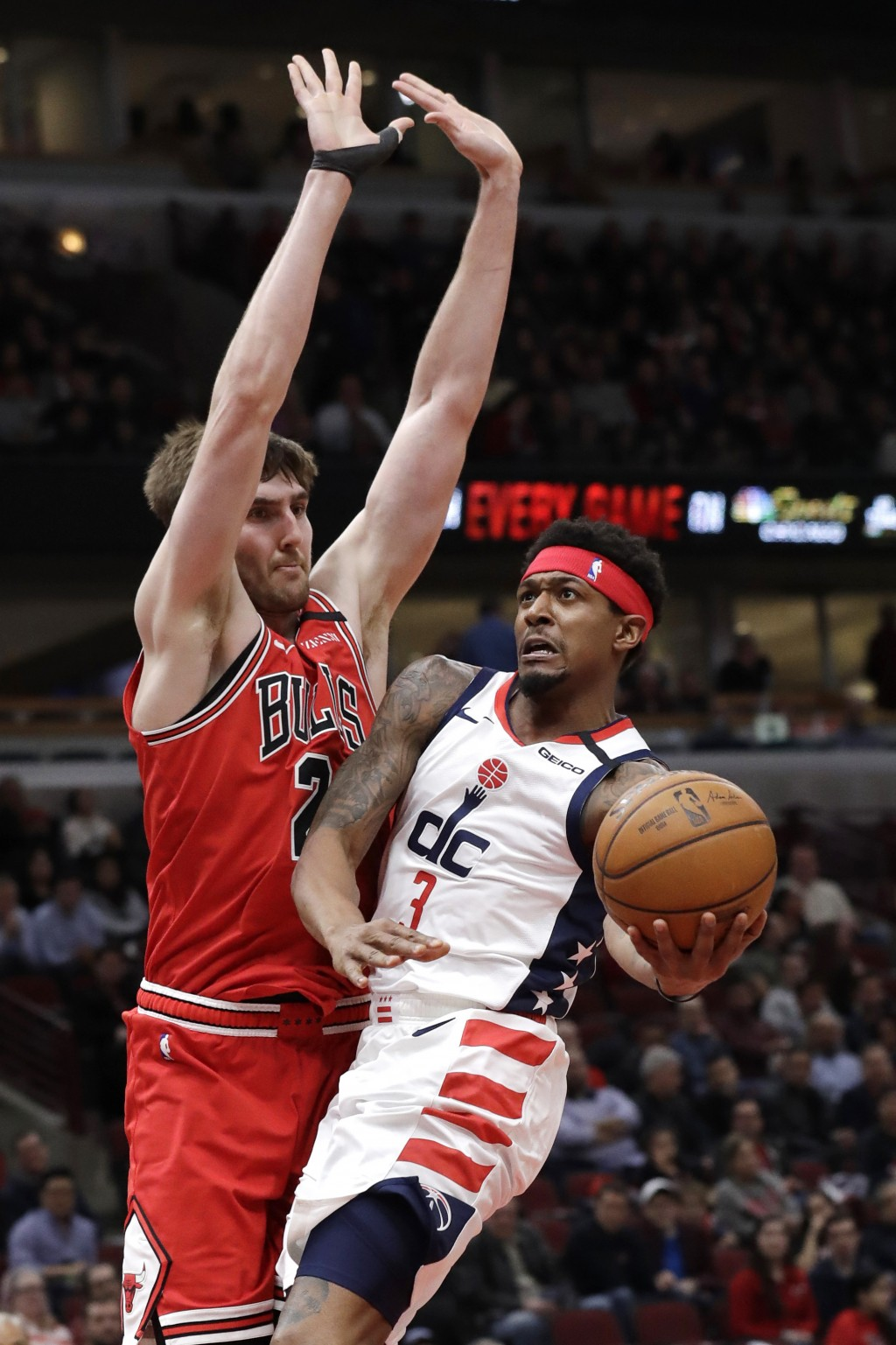 Washington Wizards guard Bradley Beal, right, drives to the basket against Chicago Bulls forward Luke Kornet during the first half of an NBA basketbal...