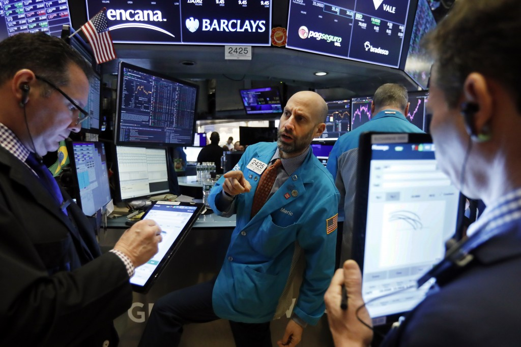 FILE - In this Jan. 10, 2020, file photo specialist Meric Greenbaum, center, works at his post on the floor of the New York Stock Exchange. The U.S. s...