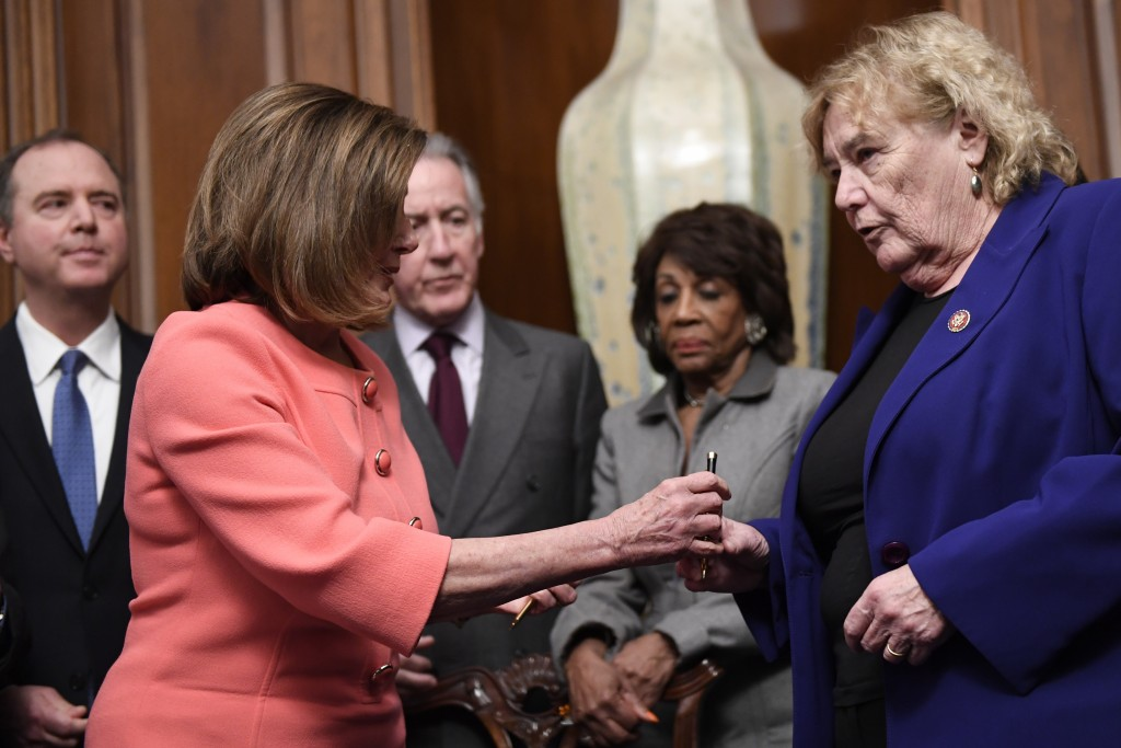 House Speaker Nancy Pelosi of Calif., second from left, gives a pen to Rep. Zoe Lofgren, D-Calif., right, after she signed the resolution to transmit ...