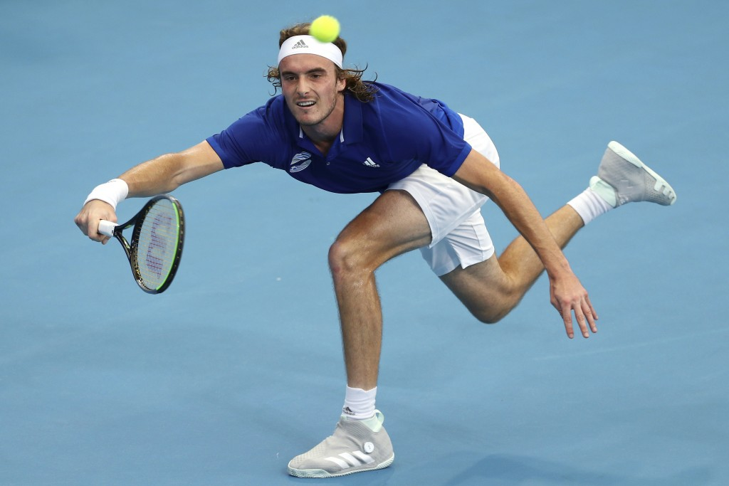 FILE - In this Jan. 3, 2020, file photo, Stefanos Tsitsipas, of Greece, plays a shot during his match against Denis Shapovalov, of Canada, at the ATP ...