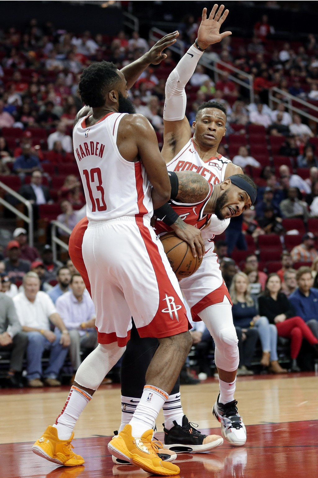 Portland Trail Blazers forward Carmelo Anthony, middle, is boxed up by Houston Rockets guard James Harden (13) and guard Russell Westbrook, back, duri...