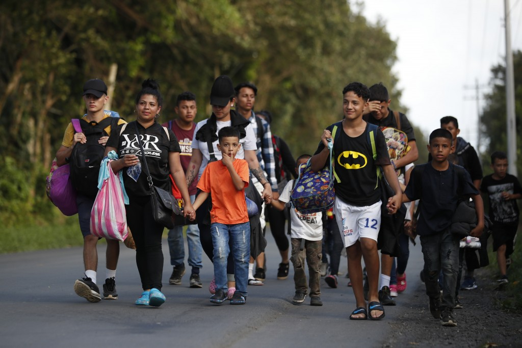 A group of migrants walks trying to make it to the United States, near El Cinchado, Guatemala, Wednesday, Jan. 15, 2020, on the border with Honduras. ...