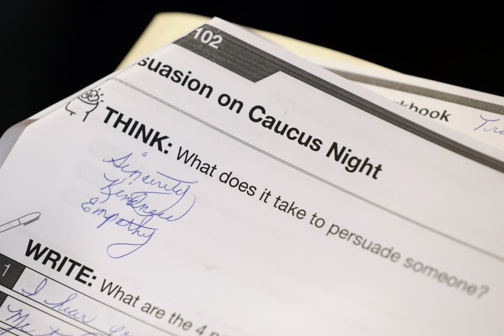 FILE - In this Jan. 9, 2020, file photo, a question in a training booklet is seen during a caucus training meeting at the local headquarters for Democ...