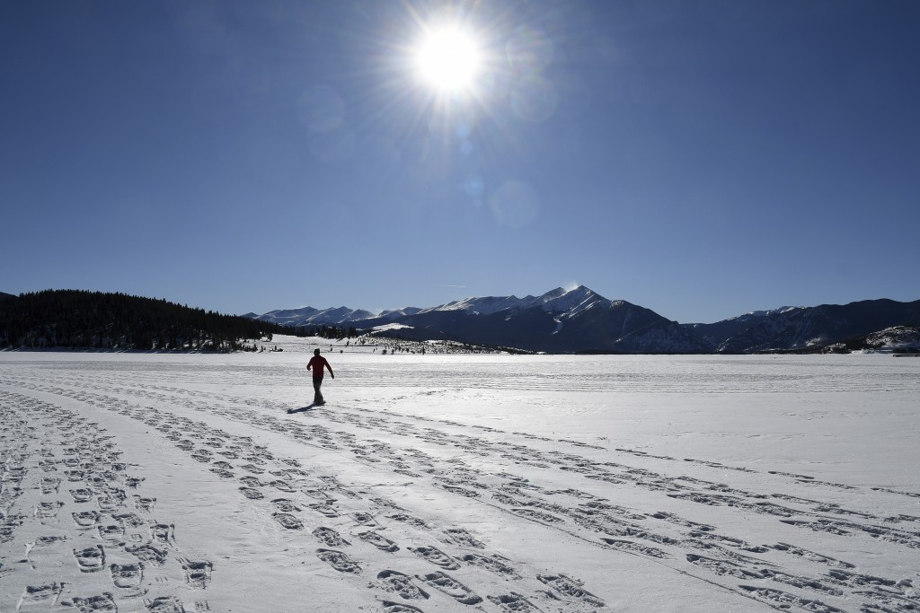 In this photo taken Jan. 7, 2020, British artist Simon Beck creates a massive geometrical design on a reservoir near Silverthorne, Colo. Beck uses sno...