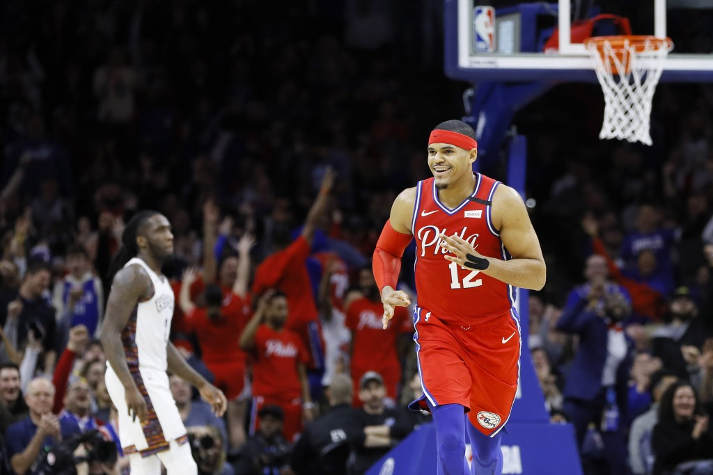 Philadelphia 76ers' Tobias Harris reacts after making a 3-pointer during the second half of an NBA basketball game against the Brooklyn Nets, Wednesda...