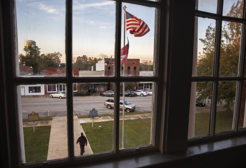 A resident leaves a meeting at the Stewart County courthouse on the town square, Tuesday, Nov. 12, 2019, in Lumpkin, Ga. A mile and a half from the St...