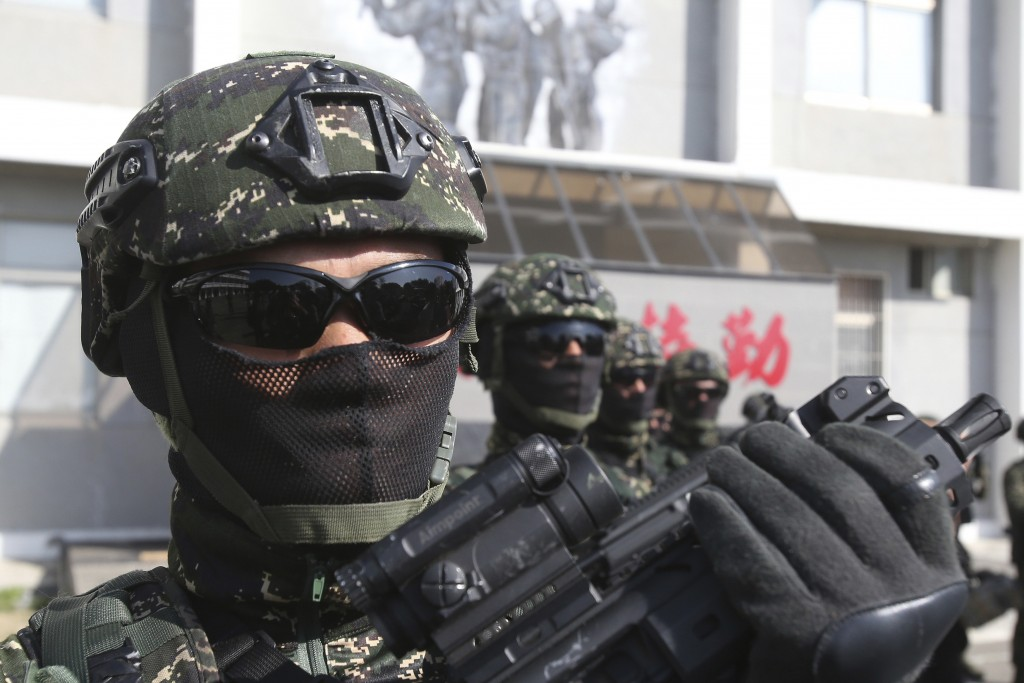 Members of Amphibious Search Team pose for the press during a military exercise in Kaohsiung, southern Taiwan, Thursday, Jan. 16, 2020. Taiwan militar...