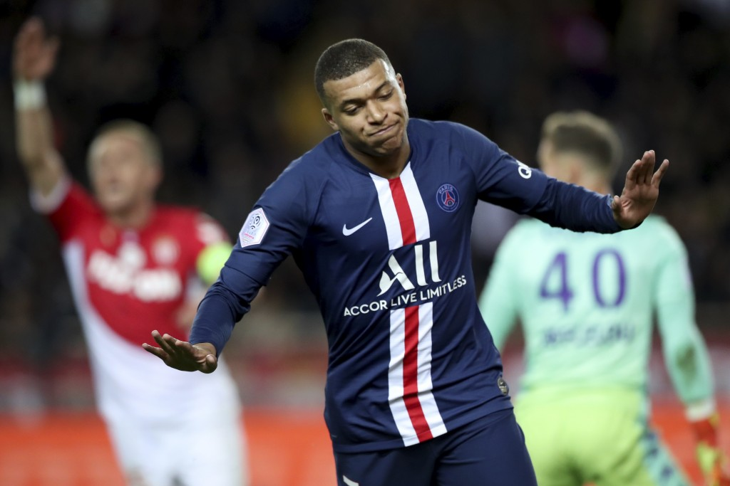 PSG's Kylian Mbappe celebrates after scoring his side's opening goal during the French League One soccer match between Monaco and Paris Saint-Germain ...