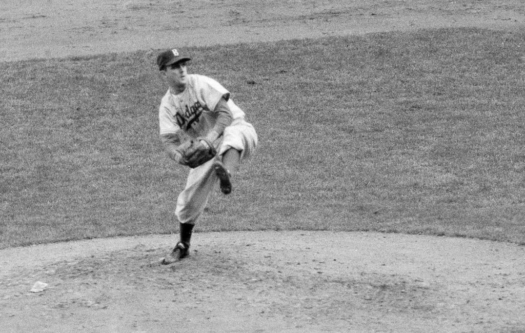FILE - In this October 1952 file photo, Brooklyn Dodgers' Carl Erskine pitches against the New York Yankees in Game 5 of the baseball World Series in ...