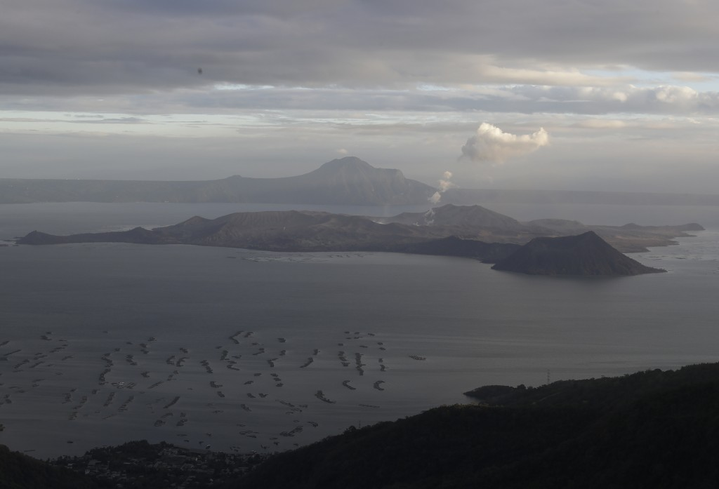 Steam comes rises from the Taal volcano in a view from Tagaytay, Cavite province, southern Philippines on Thursday Jan.16, 2020. Taal volcano belched ...