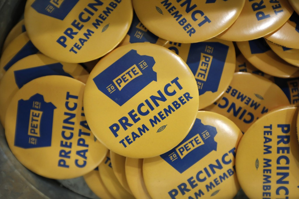 FILE - In this Jan. 9, 2020, file photo, precinct team member buttons are seen during a caucus training meeting at the local headquarters for Democrat...