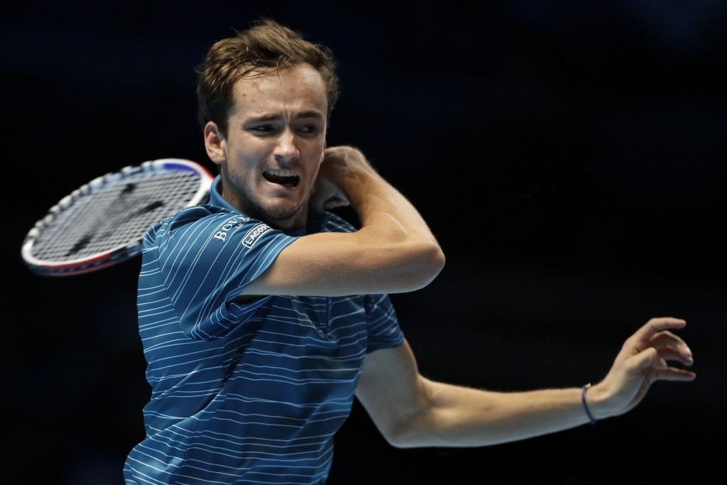 FILE - In this Nov. 11, 2019, file photo, Daniil Medvedev, of Russia, plays a return to Stefanos Tsitsipas, of Greece, during their ATP World Tour Fin...