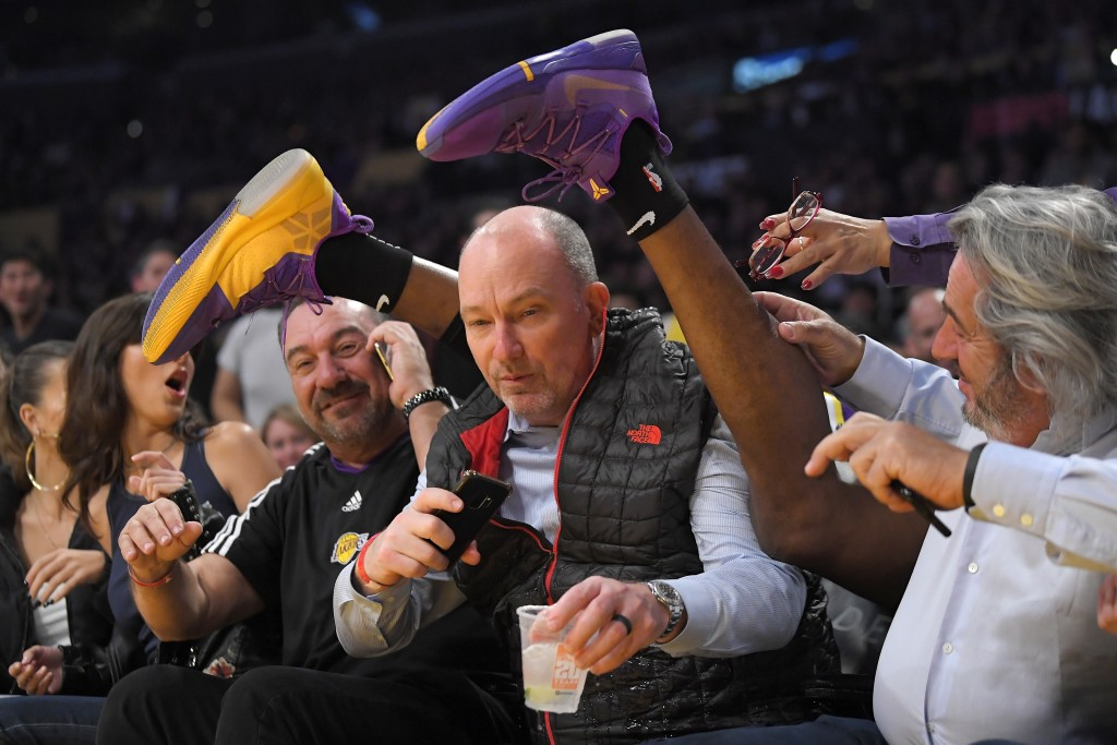 Los Angeles Lakers center Dwight Howard's feet are seen after he crashed into the seating are while chasing a loose ball during the first half of the ...