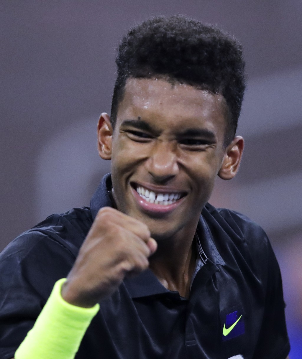 FILE  - In this Aug. 27, 2019, file photo, Felix Auger-Aliassime, of Canada, pumps his fist after winning a point against Denis Shapovalov, of Canada,...