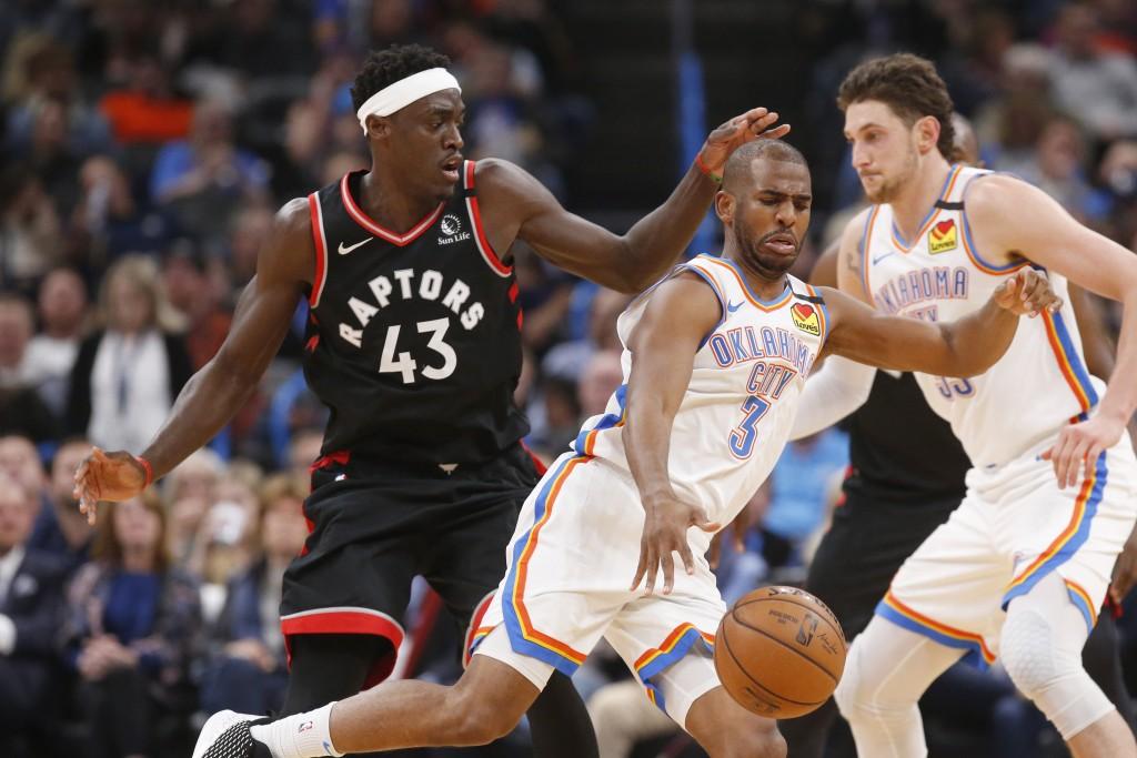 Oklahoma City Thunder guard Chris Paul (3) drives past Toronto Raptors forward Pascal Siakam (43) during the first half of an NBA basketball game Wedn...