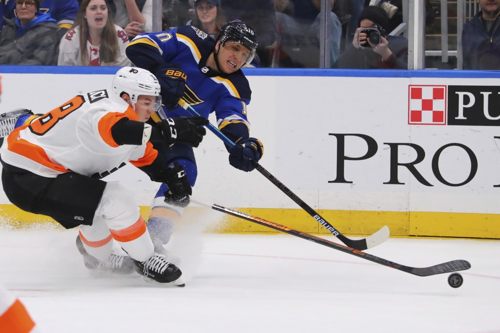 St. Louis Blues center Brayden Schenn (10) shoots the puck against Philadelphia Flyers center Tyler Pitlick (18) during the second period of an NHL ho...