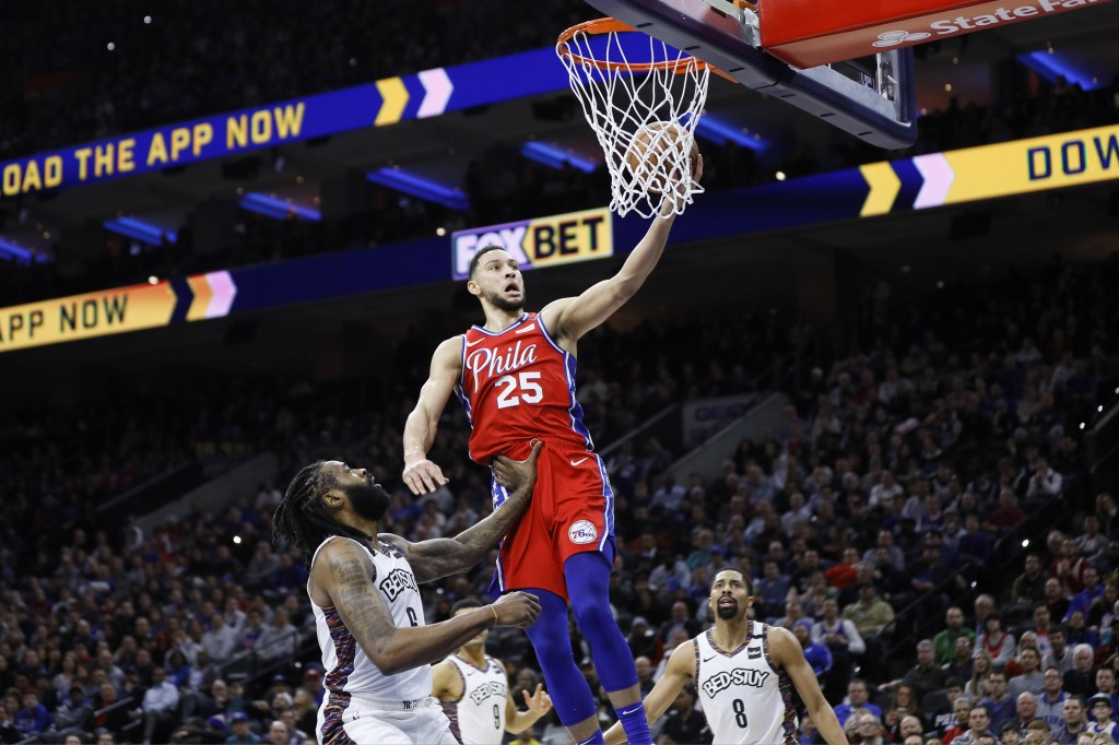 Philadelphia 76ers' Ben Simmons (25) goes up for a shot against Brooklyn Nets' DeAndre Jordan (6) during the first half of an NBA basketball game, Wed...