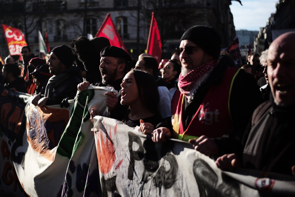 Protesters shout during a demonstration Thursday, Jan. 16, 2020 in Paris. Protesters denounce French President Emmanuel Macron's plans to overhaul the...