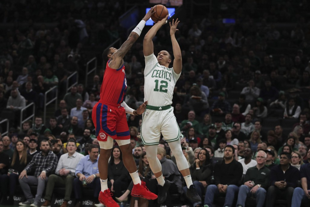 Detroit Pistons forward Markieff Morris, left, blocks a shot by Boston Celtics forward Grant Williams during the first half of an NBA basketball game ...