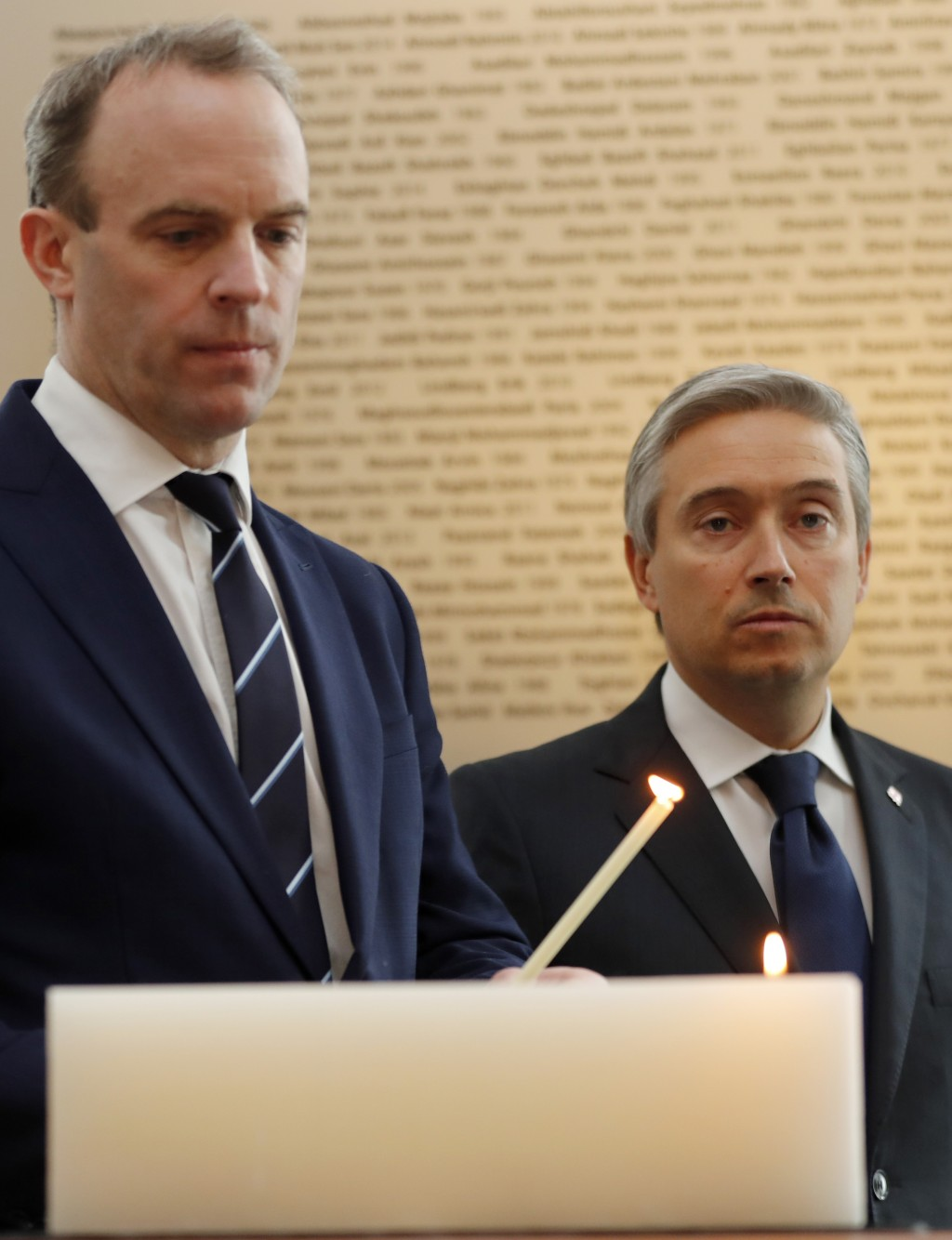 François-Philippe Champagne, Canada Minister of Foreign Affairs, right, UK's Secretary of ~State for Foreign Affair Dominic Raab light a candle in fro...