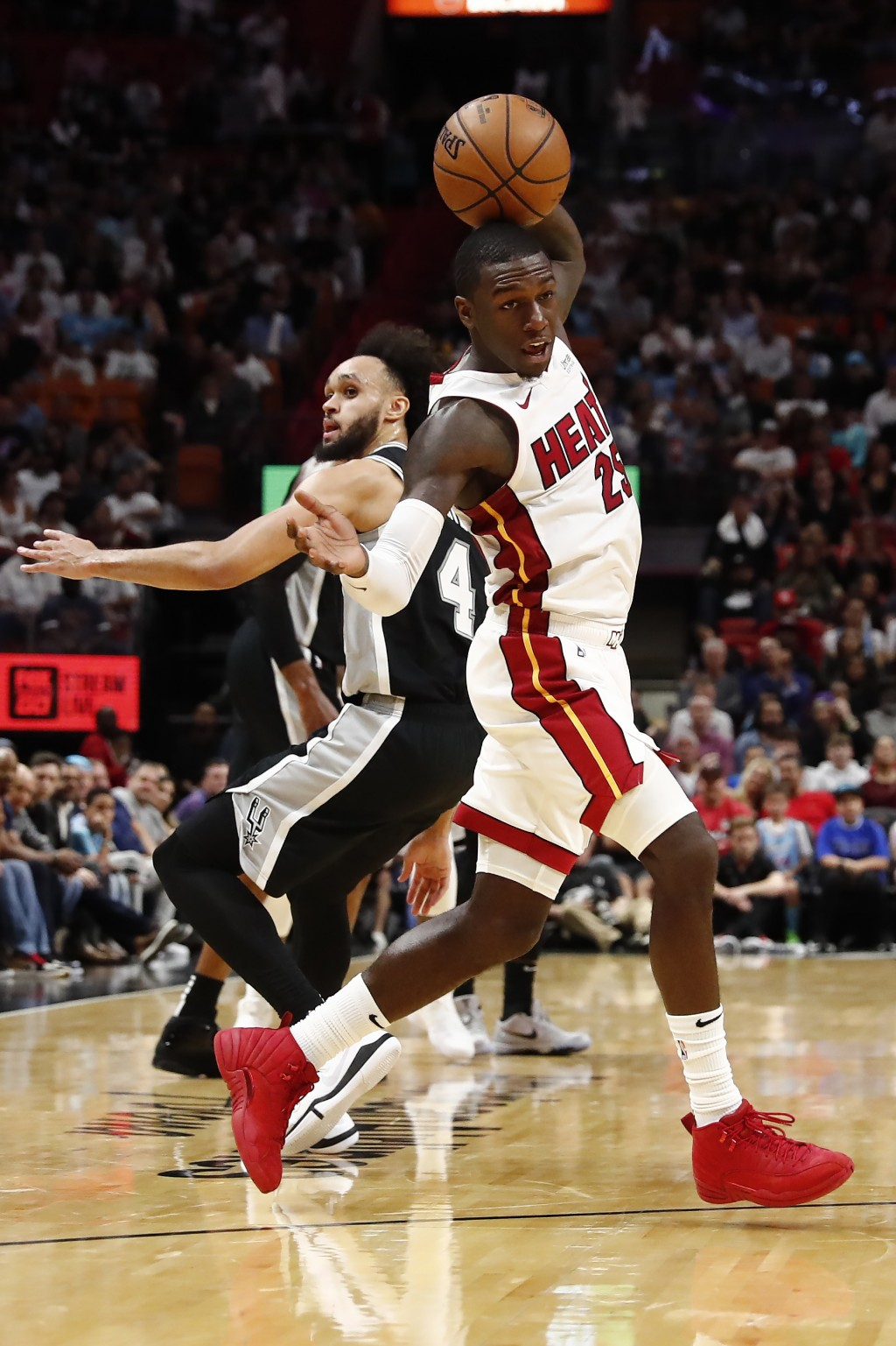 Miami Heat guard Kendrick Nunn (25) steals the ball from San Antonio Spurs guard Derrick White (4) in the second half of an NBA basketball game, Wedne...