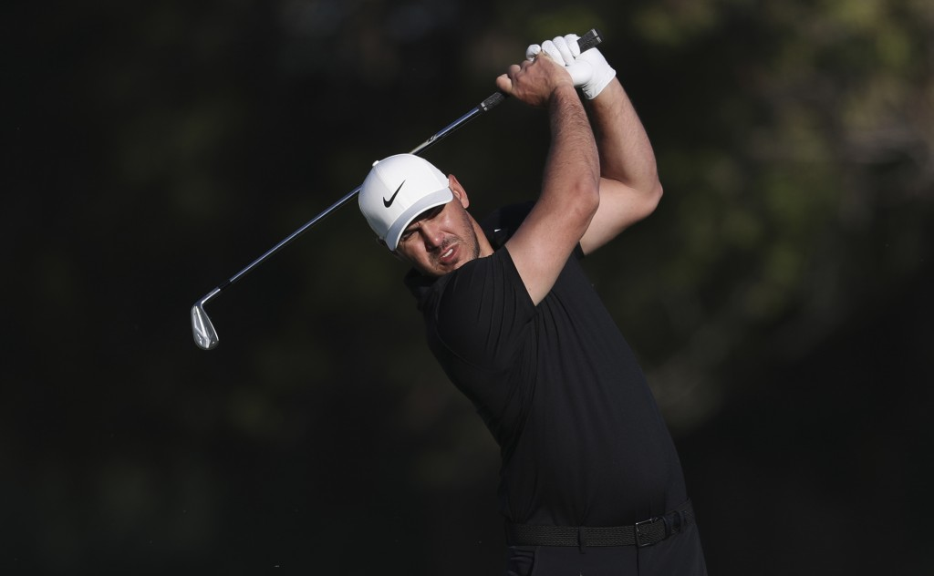 Brooks Koepka from the U.S. plays a shot on the 14th fairway during the first round one of the Abu Dhabi Championship golf tournament in Abu Dhabi, Un...
