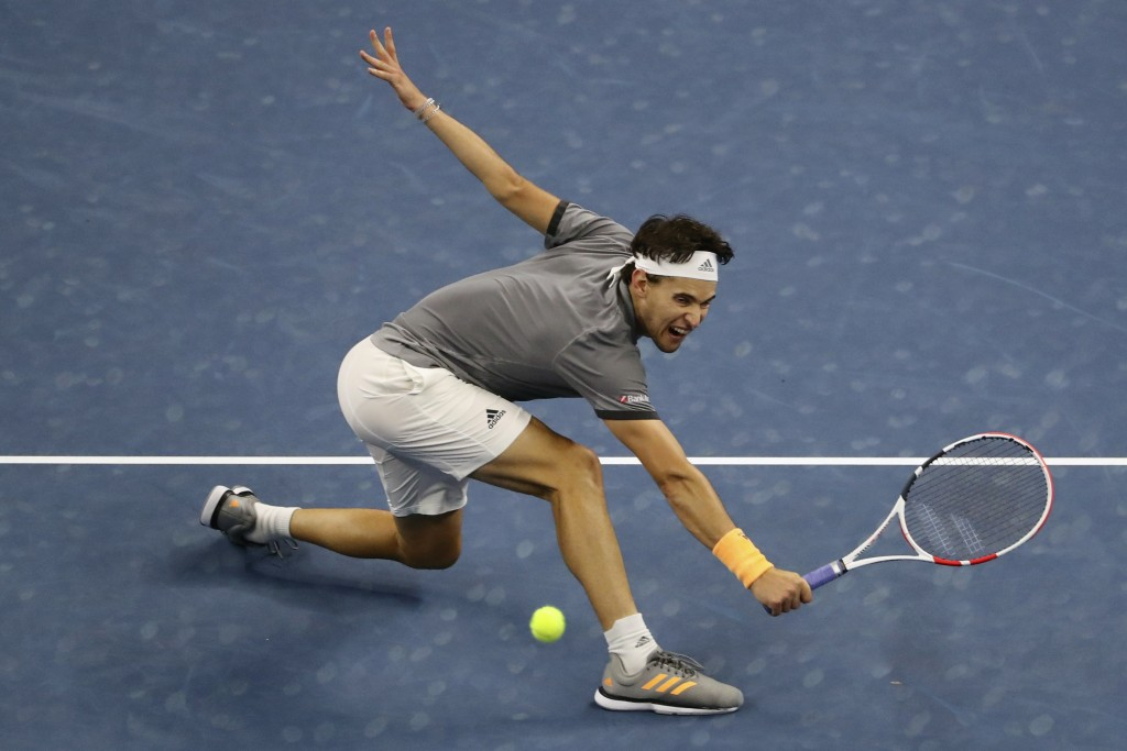 FILE - In this Oct. 6, 2019, file photo, Dominic Thiem, of Austria, hits a return shot while competing against Stefanos Tsitsipas, of Greece, during t...