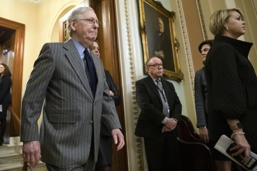Senate Majority Leader Mitch McConnell of Ky., walks from the Senate Chamber after the delivery of the articles of impeachment against President Donal...