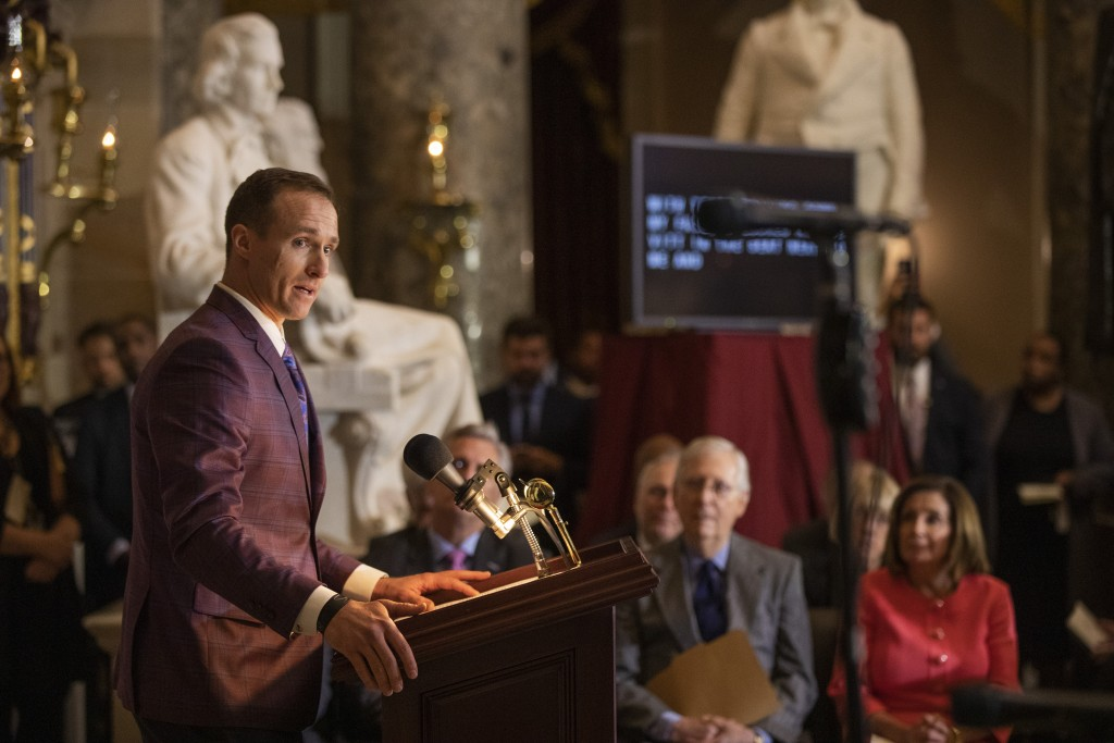 House Speaker Nancy Pelosi and Senate Majority Leader Mitch McConnell of Ky., watch and listen to Saints quarterback Drew Brees, speak during a Congre...