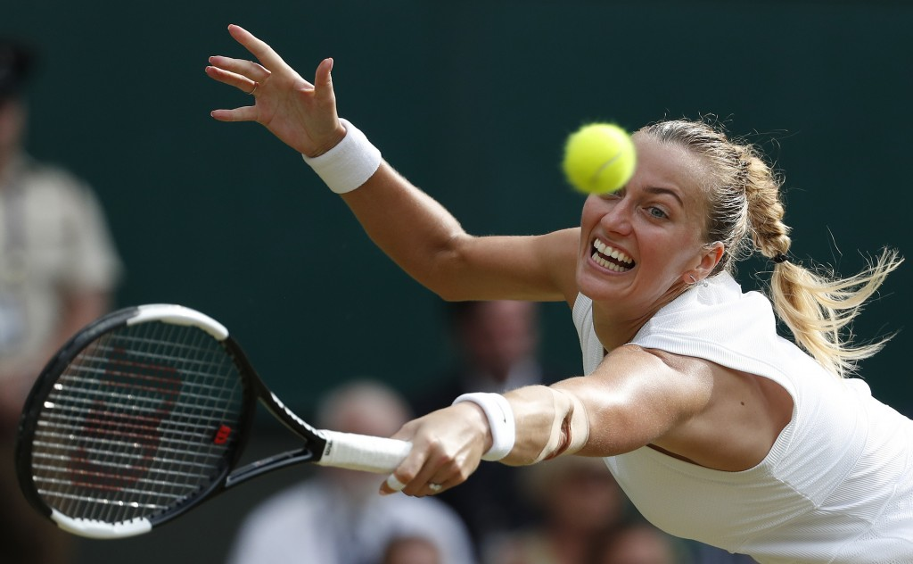 FILE - In this July 19, 2019, file photo, Czech Republic's Petra Kvitova returns to Britain's Johanna Konta in a singles match at the Wimbledon Tennis...