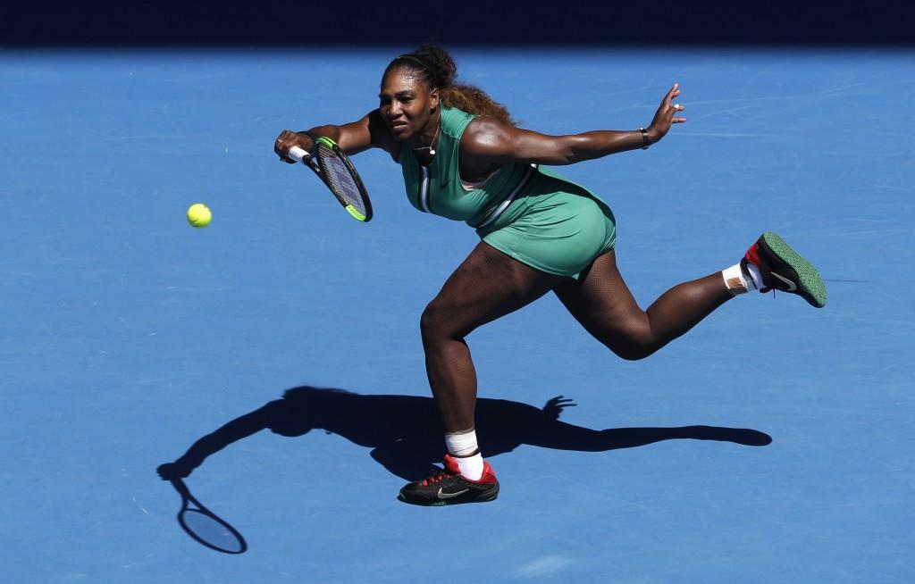 FILE - In this Jan. 23, 2019, file photo, Serena Williams makes a forehand return to Karolina Pliskova of the Czech Republic during their quarterfinal...