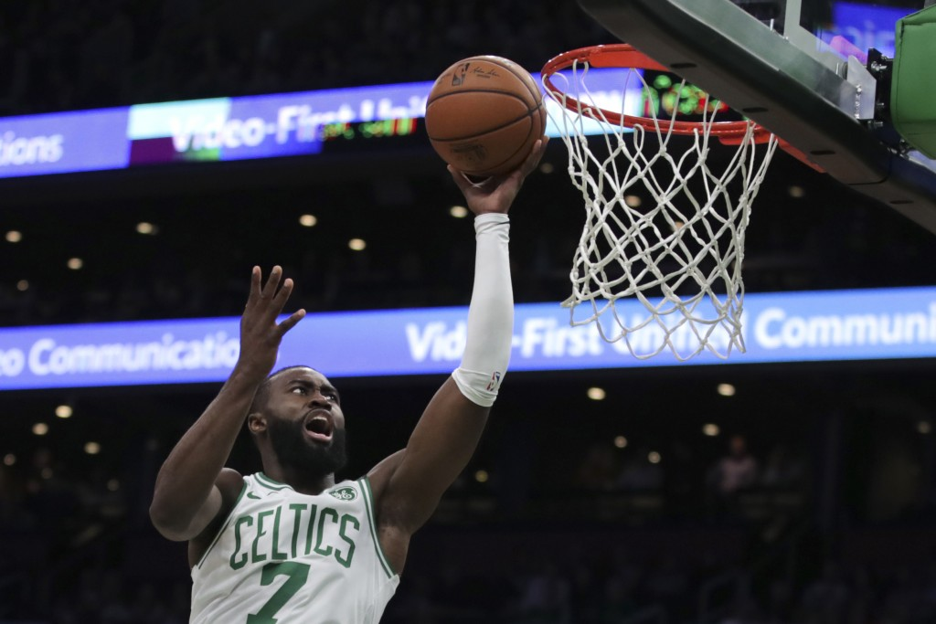 Boston Celtics guard Jaylen Brown drives to the basket against the Detroit Pistons during the first half of an NBA basketball game in Boston, Wednesda...
