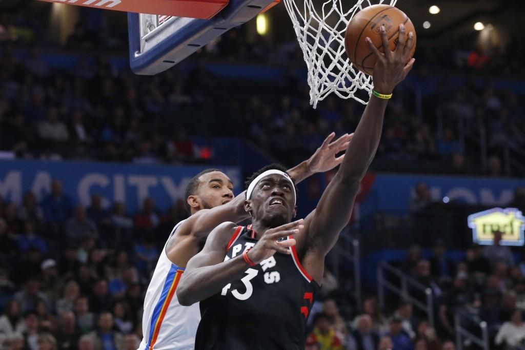 Toronto Raptors forward Pascal Siakam (43) shoots in front of Oklahoma City Thunder guard Terrance Ferguson during the first half of an NBA basketball...
