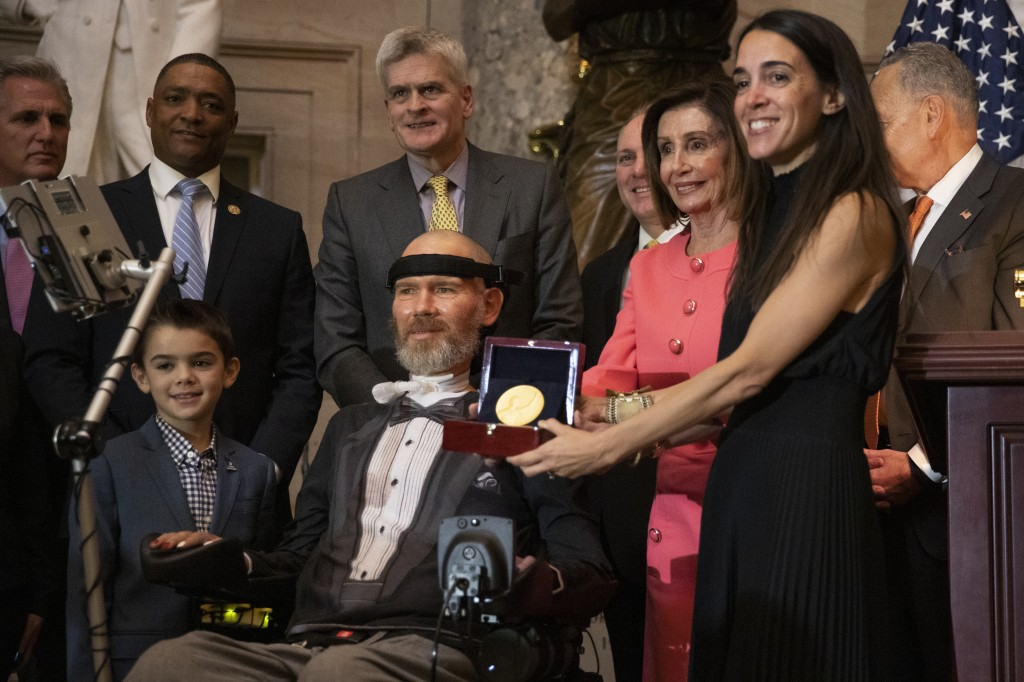 A Congressional Gold Medal is presented to amyotrophic lateral sclerosis (ALS) advocate and former National Football League (NFL) player, Steve Gleaso...
