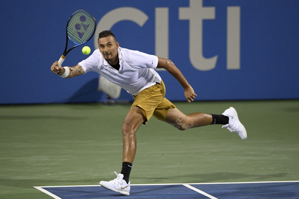 FILE - In this Aug. 2, 2019, file photo, Nick Kyrgios, of Australia, returns the ball to Norbert Gombos, of Slovakia, during the Citi Open tennis tour...
