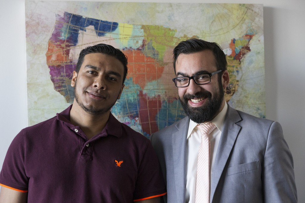 In this Jan. 6, 2020, photo, Michael Navas Gomez, left, poses for a photo with his attorney, Joshua Greer at his office in Los Angeles. Navas Gomez, w...