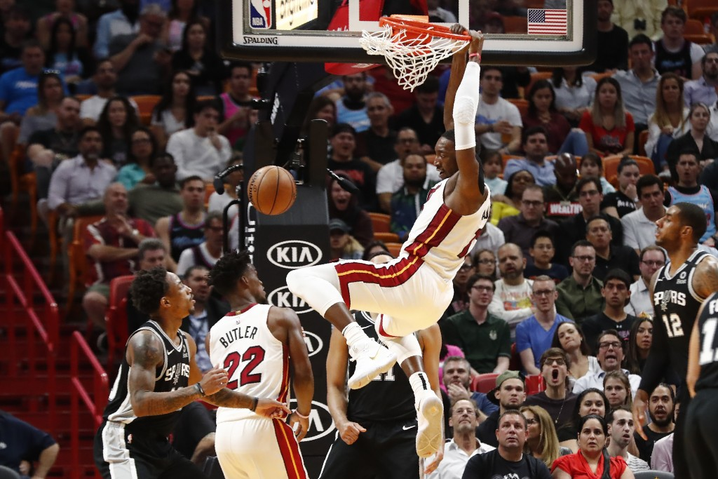 Miami Heat center Bam Adebayo (13) dunks the ball against the San Antonio Spurs in the first half of an NBA basketball game Wednesday, Jan. 15, 2020, ...