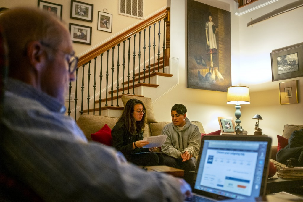 Andrea, 20, right, a transgender asylum seeker from Guatemala, goes over documents with Monica Whatley, Southern Poverty Law Center's Southeast Immigr...