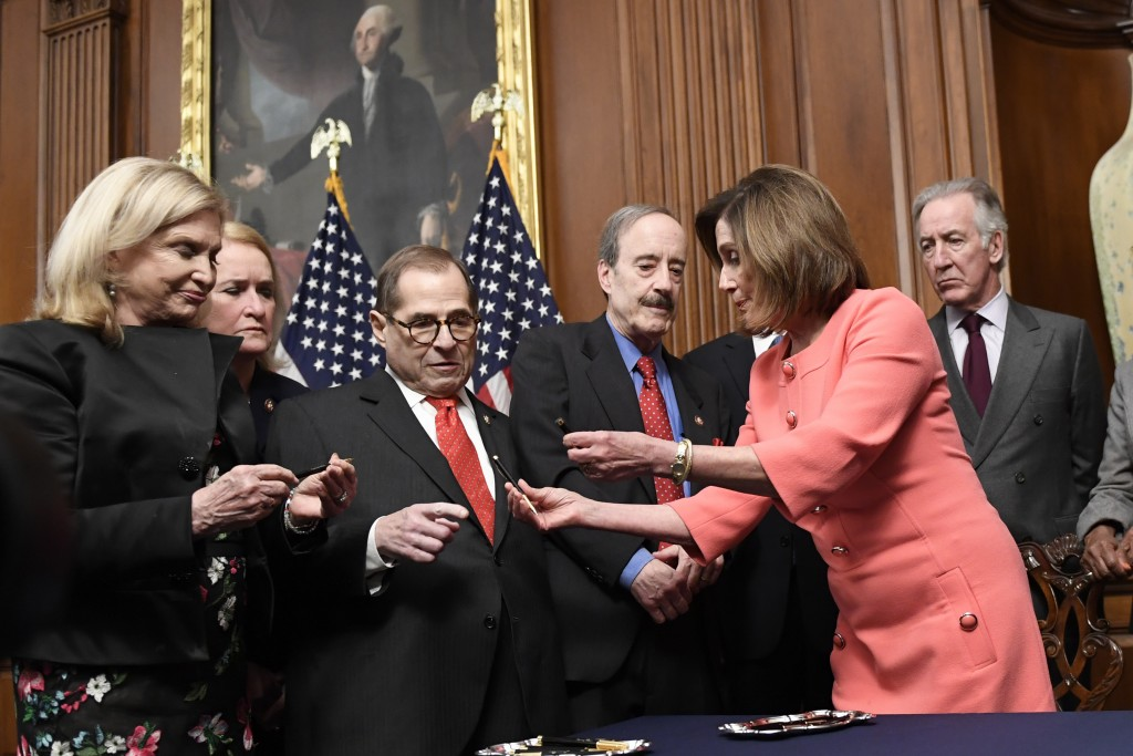 House Speaker Nancy Pelosi of Calif., second from right, gives pens to, from left, House Oversight and Government Reform Committee Chair Rep. Carolyn ...