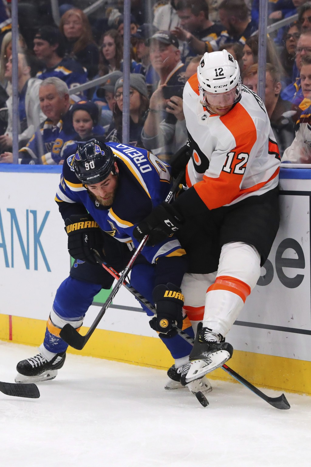 St. Louis Blues center Ryan O'Reilly (90) fights Philadelphia Flyers forward Michael Raffl (12) of Austria during the second period of an NHL hockey g...
