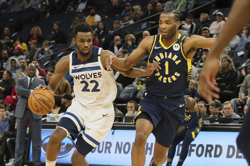 Minnesota Timberwolves' Andrew Wiggins, left, drives against Indiana Pacers' T.J. Warren in the first half of an NBA basketball game Wednesday, Jan. 1...