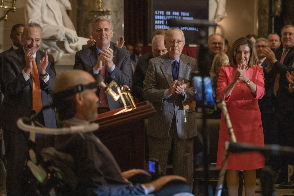 House Speaker Nancy Pelosi and Senate Majority Leader Mitch McConnell of Ky., and other Congressional leadership other members of Congress applaud dur...